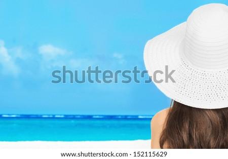 summer holidays, vacation and beach concept - girl posing in bikini on the beach - stock photo
