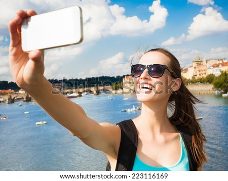 Summer, holidays, vacation and happiness concept - Woman taking a selfie self portrait with smart phone mobile - stock photo
