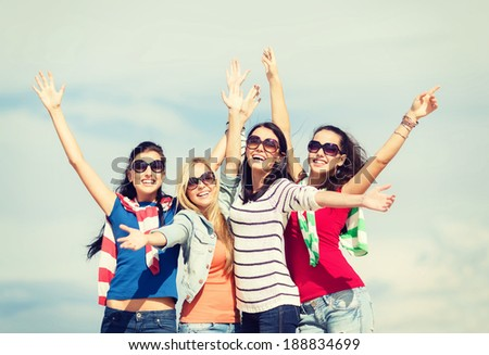 summer, holidays, vacation, happy people concept - beautiful teenage girls or young women having fun on the beach - stock photo
