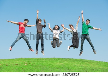 summer, holidays, vacation, happy people concept - group of friends jumping on the park - stock photo