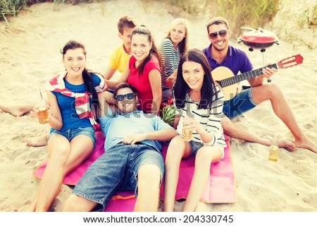 summer holidays, vacation, music, happy people concept - group of friends with guitar having fun on the beach - stock photo