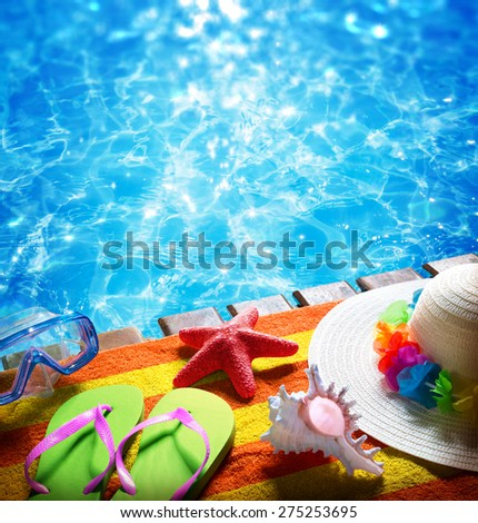 summer holidays - with towel, pool, sandals, hat and starfish
