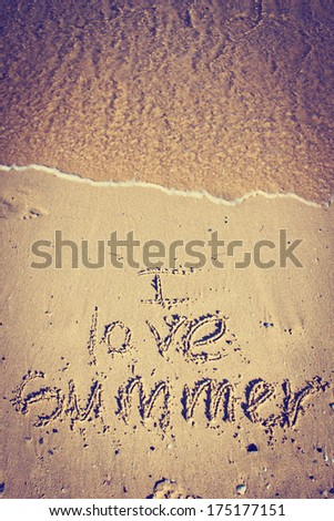 Summer holidays word  written in sand/ summer vacation background - stock photo