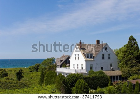 Summer homes located by the beautiful coast line. - stock photo