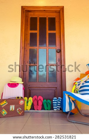 Summer house. Flip-flops, vintage suitcase. Travel and vacation concept - stock photo