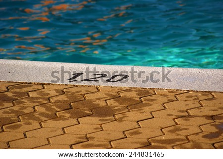Summer in the city swimming pool  water and concrete pavement - stock photo