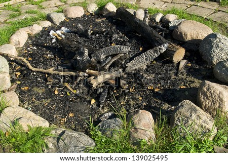 Summer in the open air, fireplace surrounded by stone . - stock photo