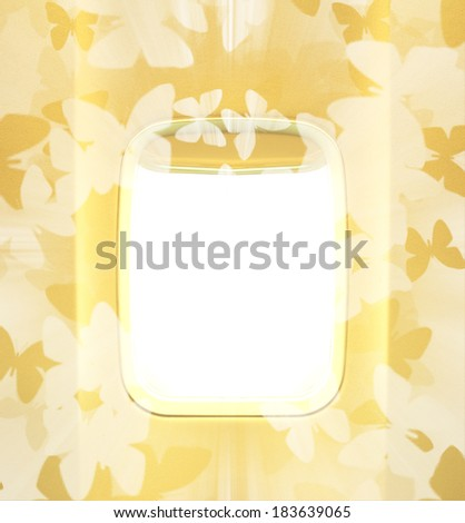 Summer journey and adventure concept. Day and sun light in the aircraft's porthole with gold or yellow tones and butterfly theme with radial rays.  Background of business voyage or trip. - stock photo