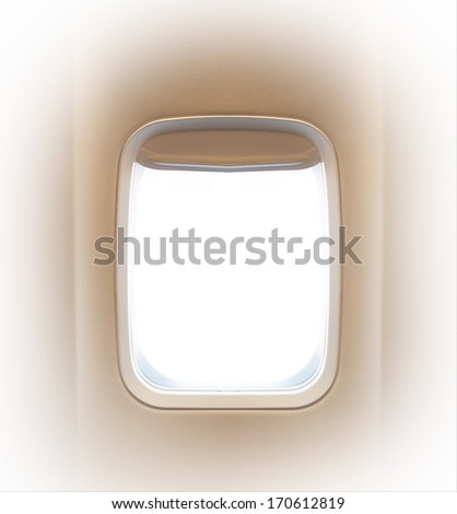 Summer journey and adventure concept. Day light in the aircraft's porthole.  Background of business voyage or trip. - stock photo