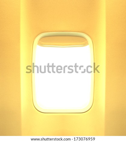 Summer journey and adventure concept. Day light in the aircraft's porthole with gold or yellow tones.  Background of business voyage or trip. - stock photo