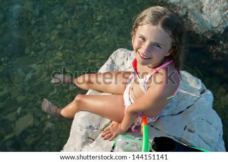 Summer joy, beach - young girl diver in the sea, active child concept - stock photo