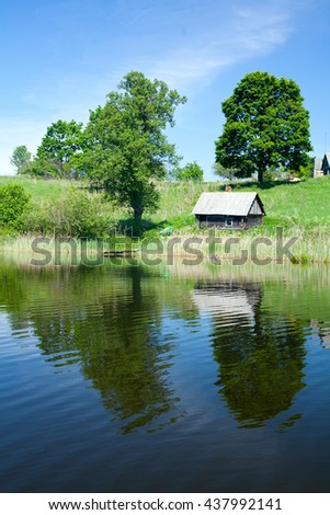 summer lake and house - stock photo