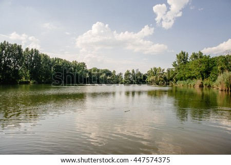 Summer lake, landscape with blue sky and lake - stock photo