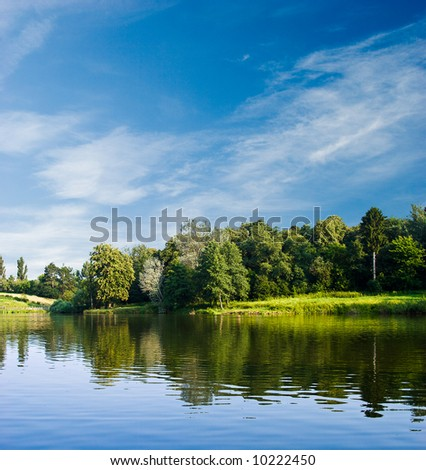 summer landscape and water surface - stock photo
