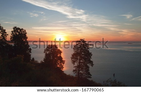 Summer landscape beautiful scenic sunrise over the river in the early misty morning - stock photo