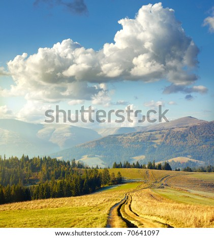 Summer landscape. Clouds and mountain road - stock photo