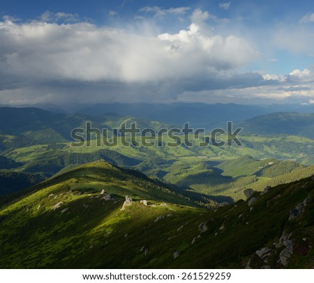 Summer landscape in the mountains. Beautiful clouds over the hills. Carpathians, Ukraine, Europe - stock photo