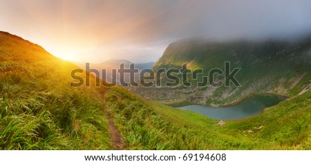 Summer landscape in the mountains near the lake. Sunrise - stock photo