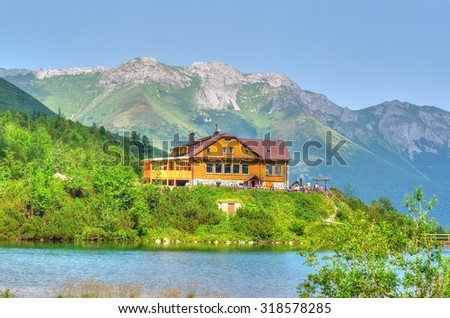 Summer landscape. Lake and mountain chalet. Zelene Pleso lake and chalet in High Tatra Mountains, Slovakia.