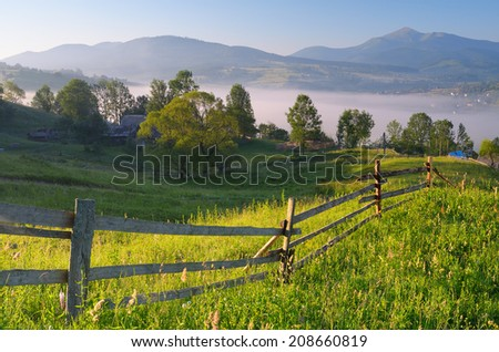 Summer landscape. Morning in a mountain village - stock photo