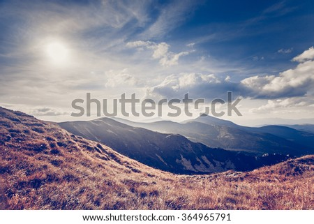 summer landscape. mountain path on the blue sky background. Panorama - stock photo