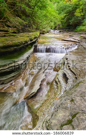 Summer Landscape of Stream in Rocky River Bed - stock photo