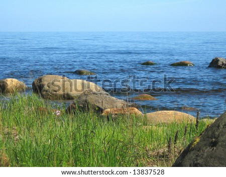 Summer landscape of the lake with the stones - stock photo