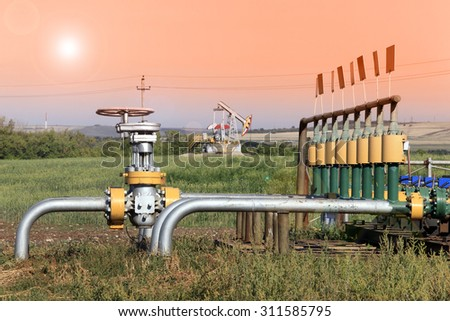 summer landscape oil pipeline in a field on a clear sunny day