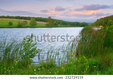 Summer landscape pond. Evening with beautiful clouds - stock photo