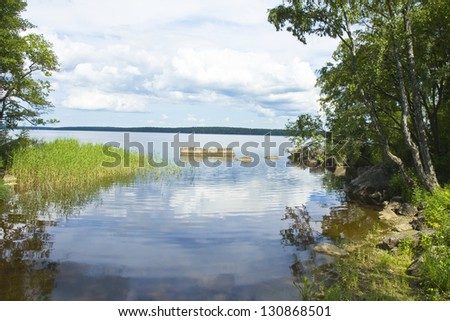 Summer landscape recorded in park Monrepo near town Vyborg in Russia on bank of Gulf of Finland.