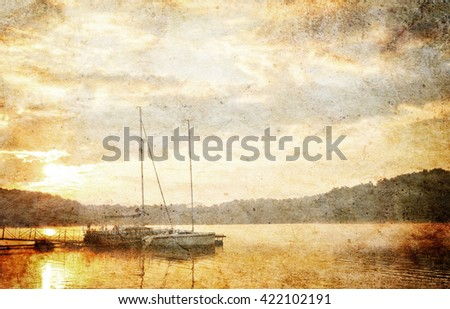 Summer landscape - sunset over lake with boats - vintage style - stock photo