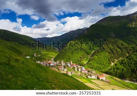 Summer landscape. The traditional mountain village. Old houses made of stone. Main Caucasian ridge. Zemo Svaneti, Georgia  - stock photo