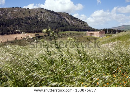 summer landscape with ancient Roman temple of Venus, Segesta village, Sicily, Italy - stock photo