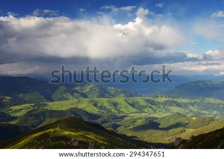Summer landscape with beautiful clouds in the mountains. Sunny day and good weather. Carpathians, Ukraine, Europe - stock photo