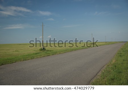 Summer landscape with empty road. Biker consept
