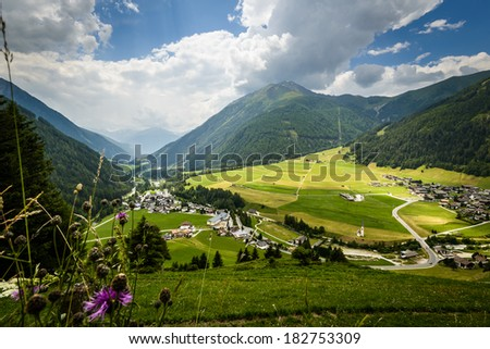 Summer landscape with fields and mountains--Kals am Grossglokner,Styria,Austria.  - stock photo
