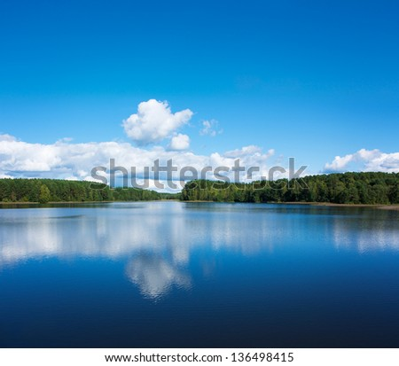 Summer Landscape with Lake and Clouds - stock photo