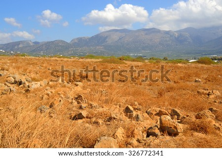 Summer landscape with mountains and dry grass in Crete, Greece.