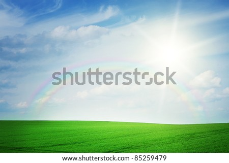 Summer landscape with rainbow - stock photo