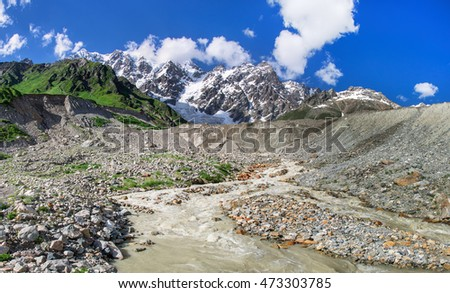 Summer landscape with river and mountain snow. Peak Shkhara Zemo Svaneti, Georgia. The main Caucasian ridge