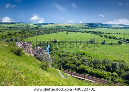 Summer landscape with river,  railway and cave temple in Divnogorie. Voronezh region. Russia