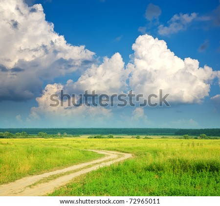 Summer landscape with road and cloudy sky