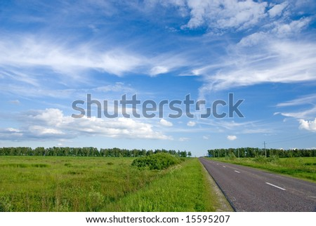 Summer landscape with rural road and cloudy sky - stock photo