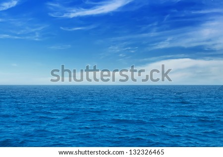 Summer landscape with sea and horizon over water - stock photo