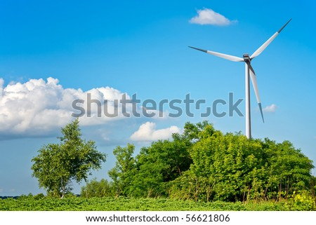 Summer landscape with wind turbine - stock photo