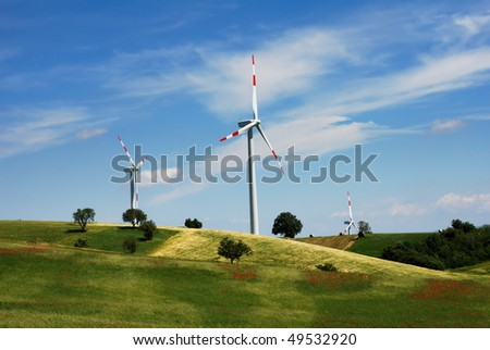 Summer landscape with wind turbines and cultivated fields