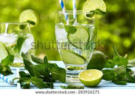 Summer lemonade mojito with lime and mint. - stock photo