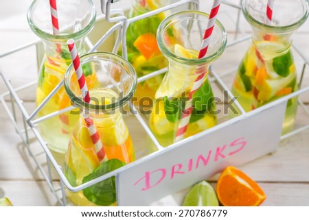 Summer lemonade with citrus and mint leaf