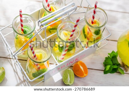 Summer lemonade with orange and lemon