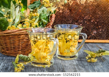 Summer lime tea with honey served in the garden - stock photo